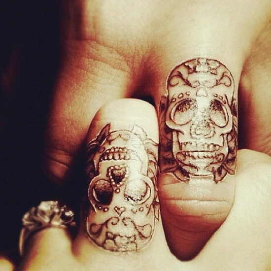 sugar skull finger tattoo