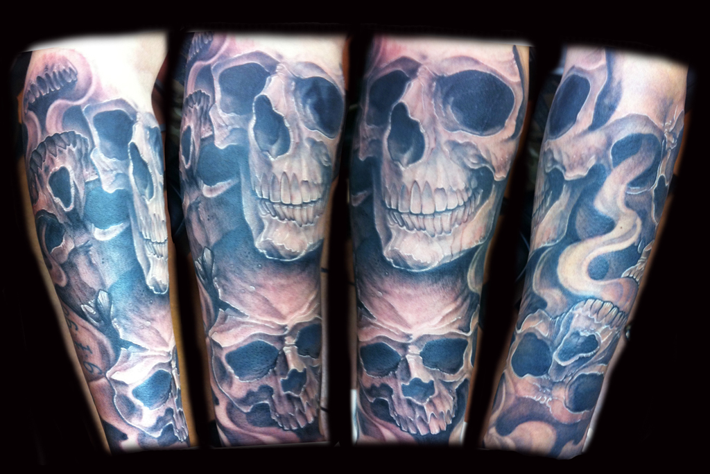 DAVID EKSTROM skull black and grey forearm tattoo