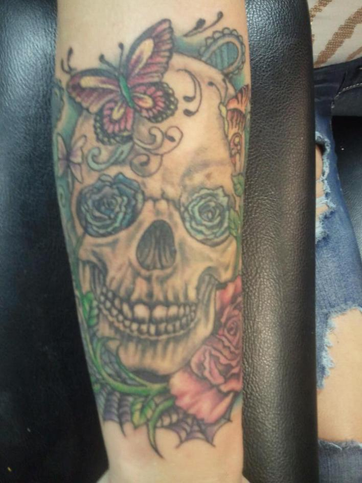forearm skull and butterfly tattoo