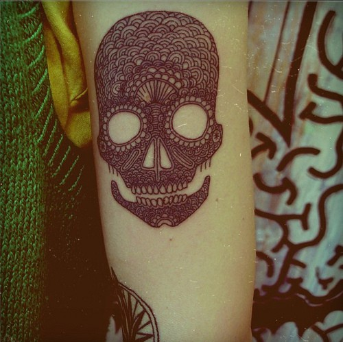 pattern skull tattoo on forearm