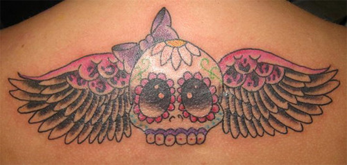 sugar skull and wings tattoo