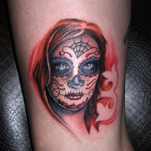 sugar skull face tattoo