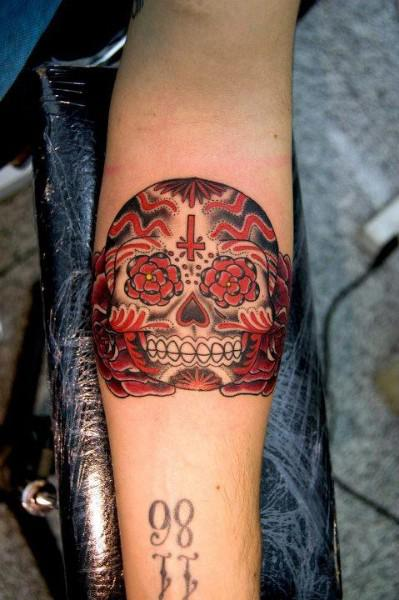 sugar skull tattoo on forearm