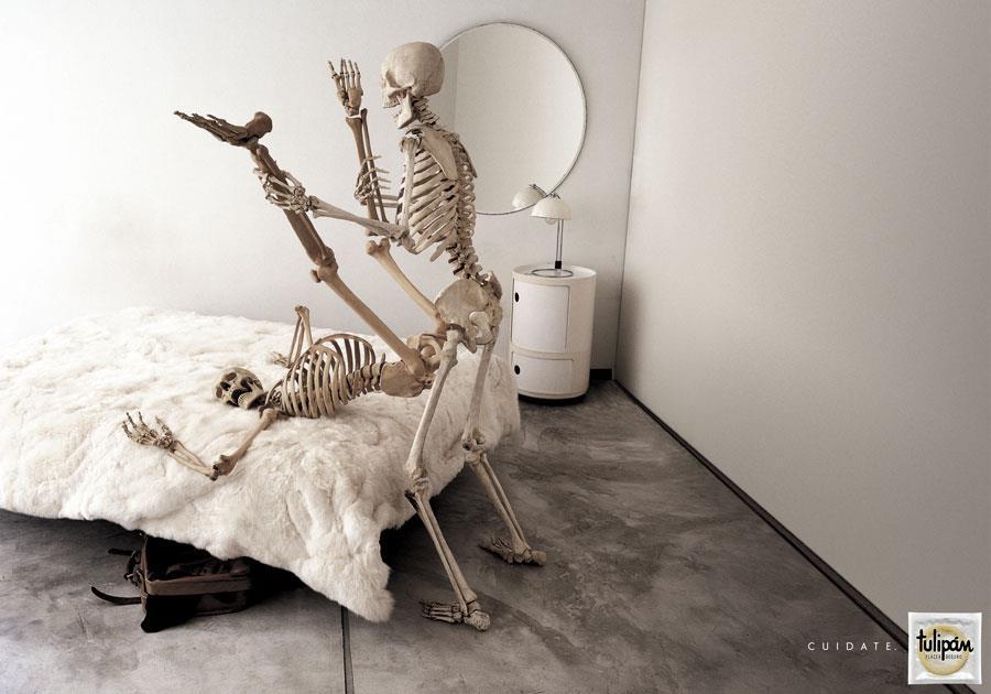 Condom Advertising Skeletons Having Sex
