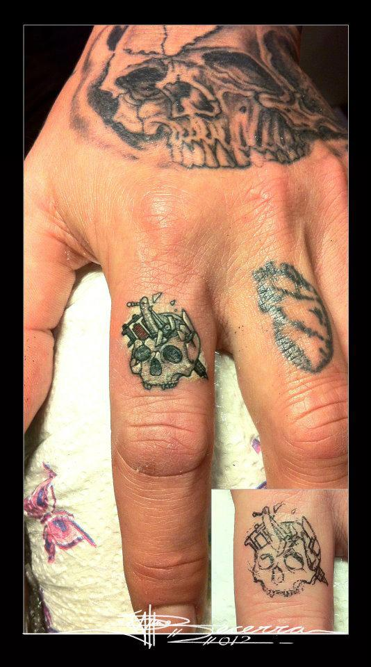 Skull finger tattoos by J Becerra