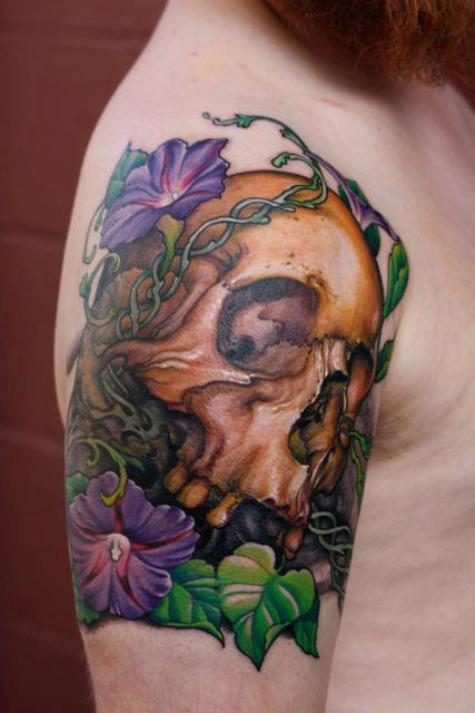 Skull tattoos by Jeff Gogue