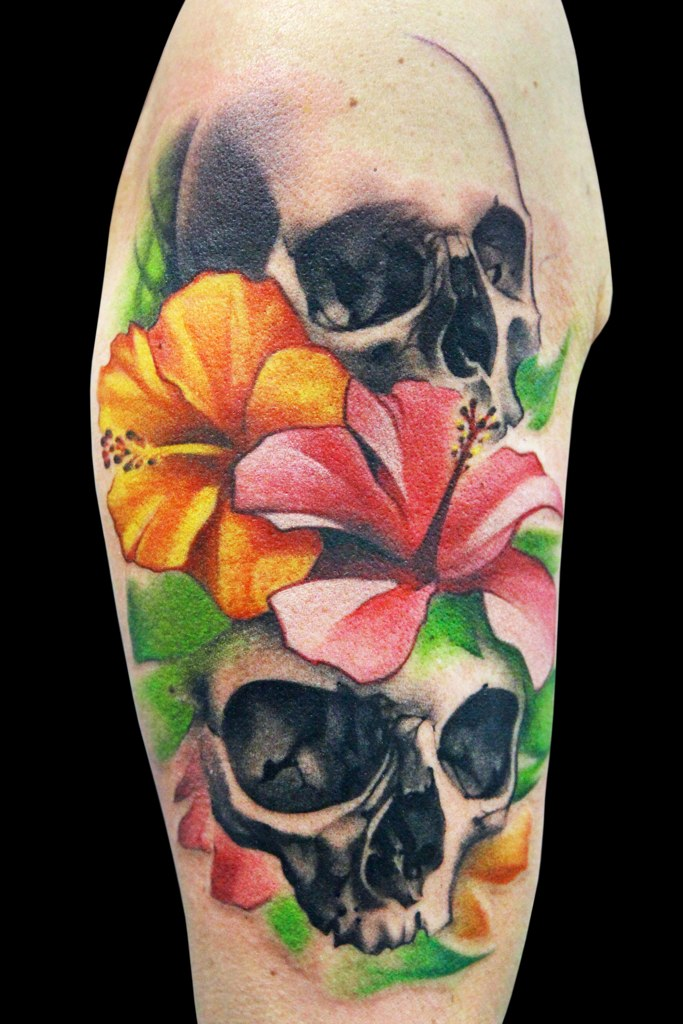 Skulls and flowers tattoo