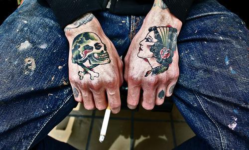 Skull-hand-tattoos