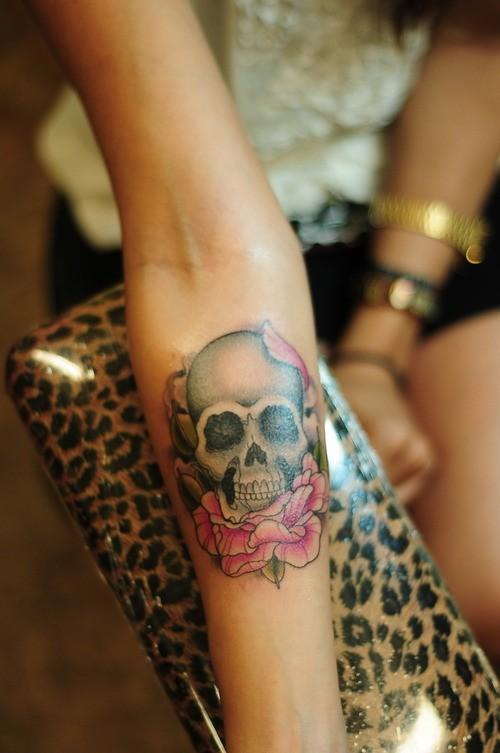 rose and skull tattoos