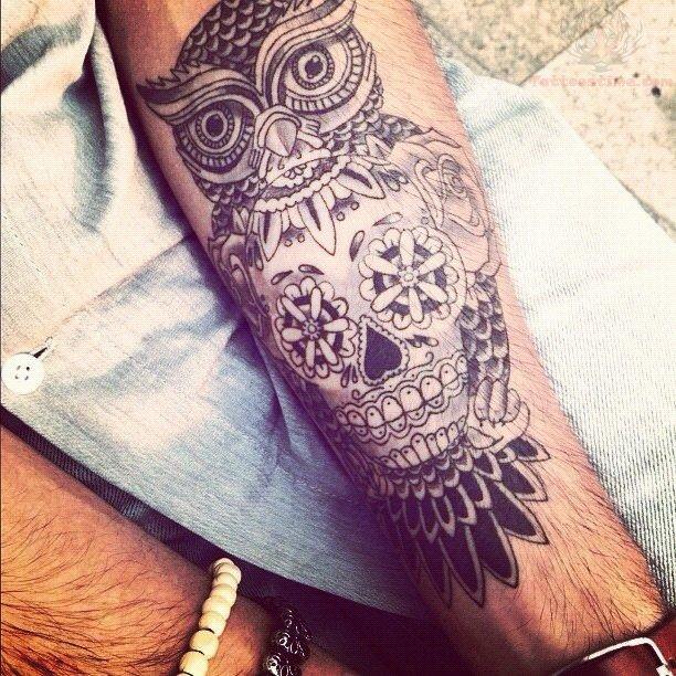 sugar skull and owl tattoo on arm