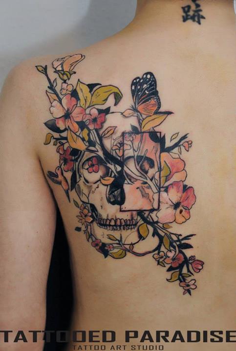 Skull and flowers tattoo by Aleksandra Katsan