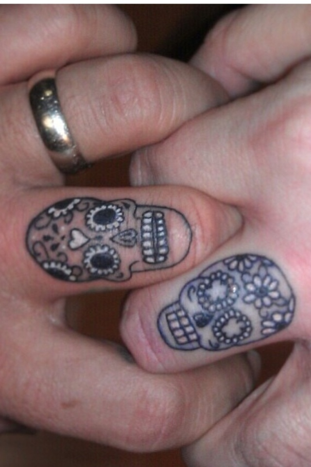 Wedding ring tattoo Skulls ring tattoo