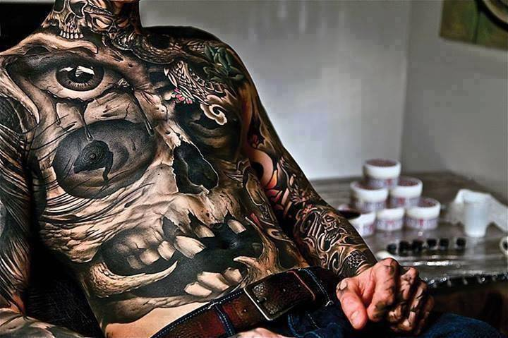Amazing skull tattoo by John Anderton