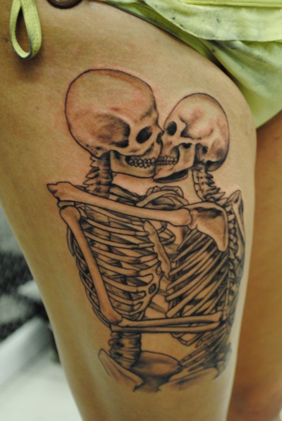 Kissing skeletons tattoo