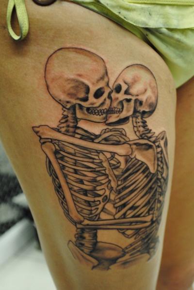 Kissing skeletons tattoo