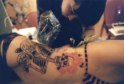girl ink rose skeleton tattoo