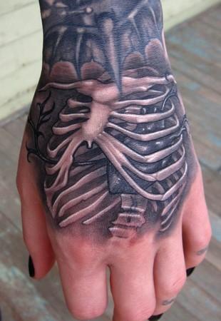 skeleton rib cage hand tattoo1