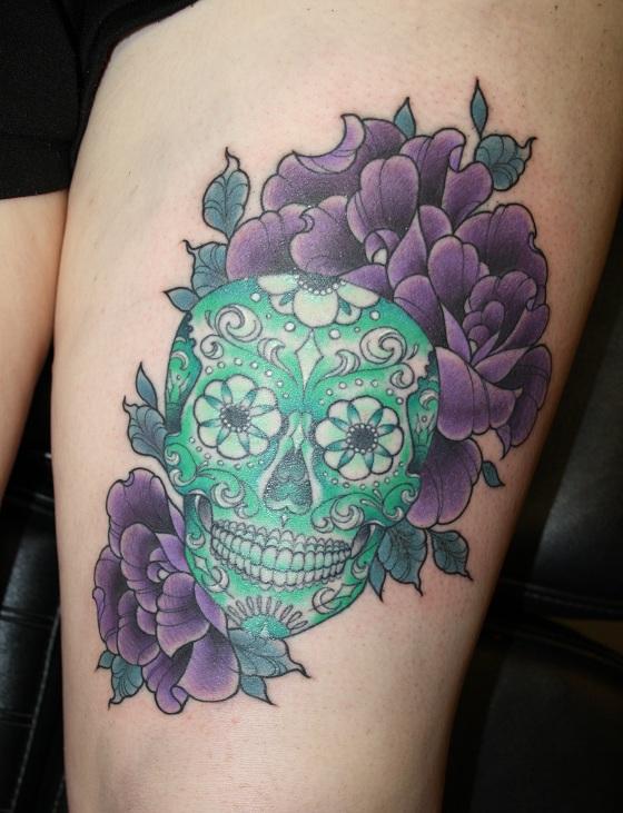 Emerald skull tattoo