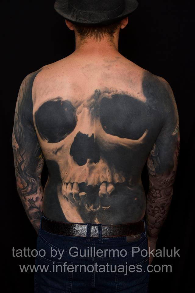 Fabulous skull back tattoos by Guillermo Pokaluk