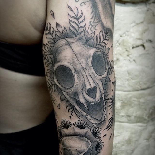 animal skull tattoo by San