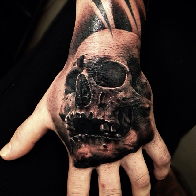 Skull hand Tattoo by Drew Apicture