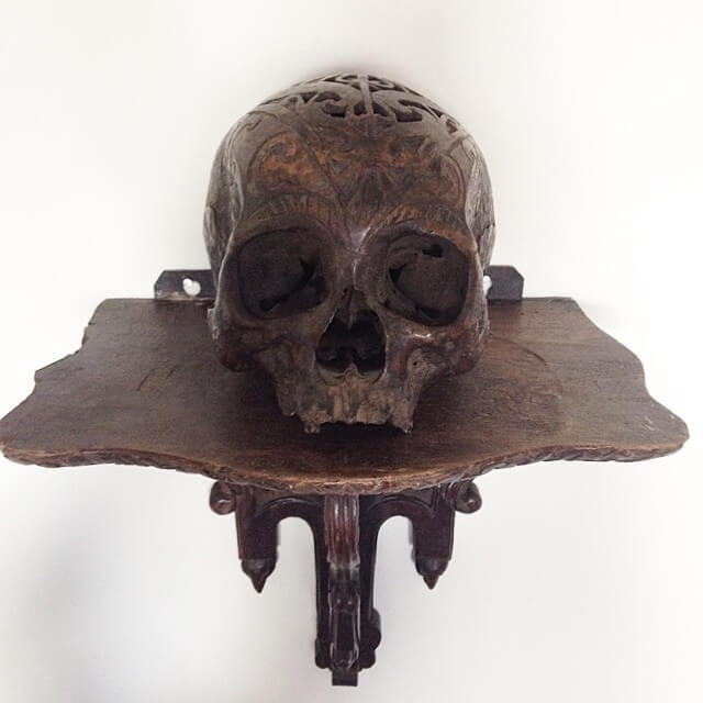 carved skull on a hand carved base